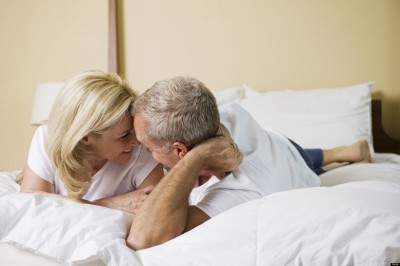 Couple Lying on Bed Smiling